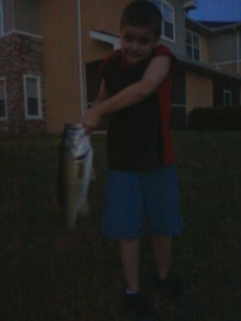 """My son with 23"""" Bass"""