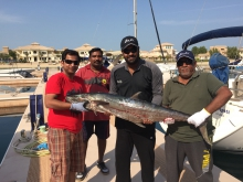 happy family catching a big king dubai